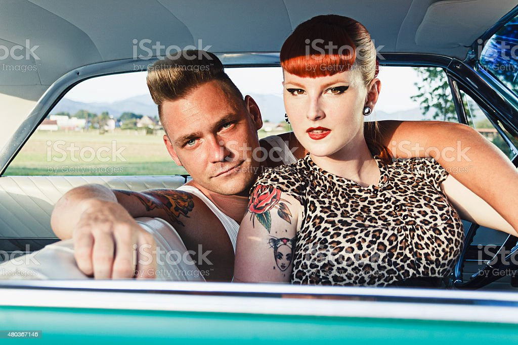 Rockabilly couple in a car stock photo
