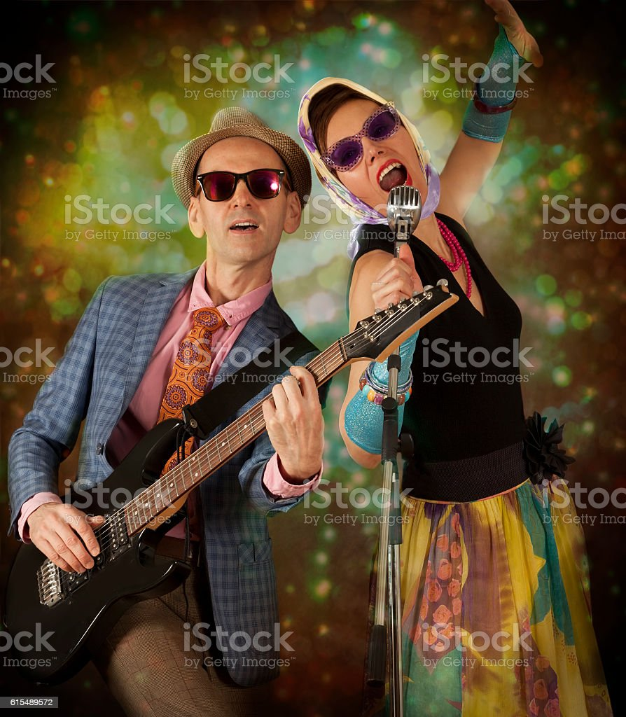 Rockabilly couple playing the guitar and singing stock photo