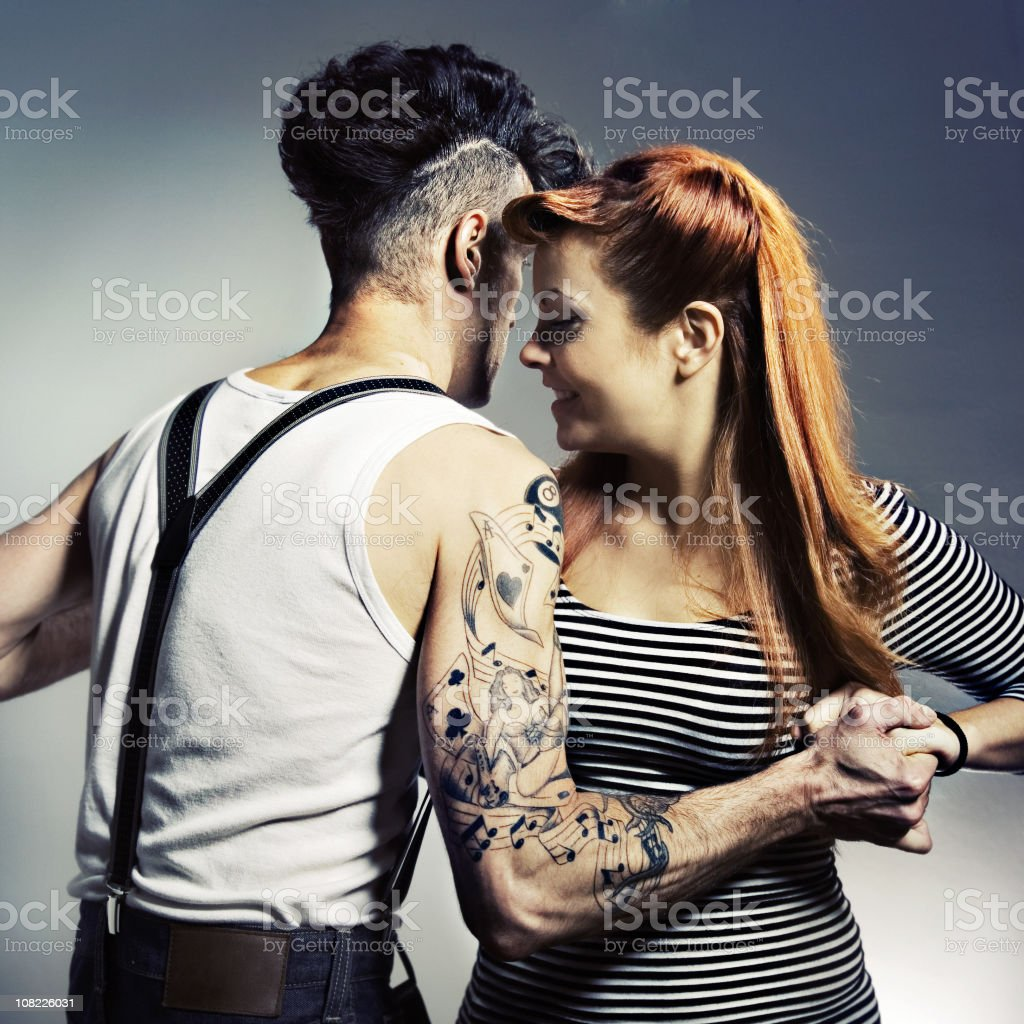 Rockabilly Man and Woman Holding Hands Dancing stock photo