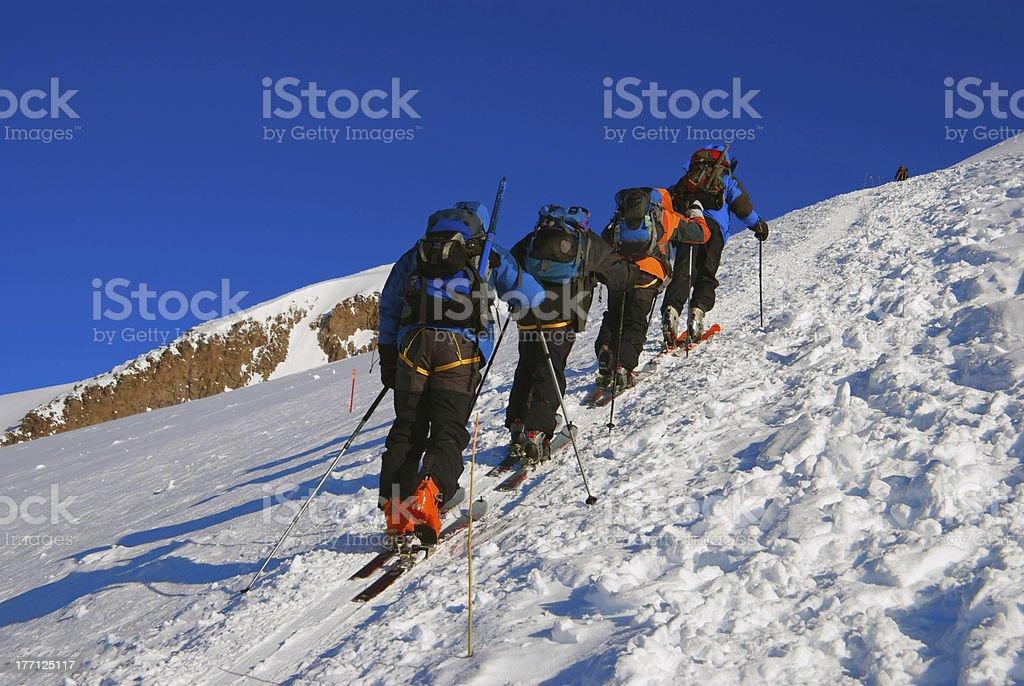 Rock-climbers walk up a mountain royalty-free stock photo