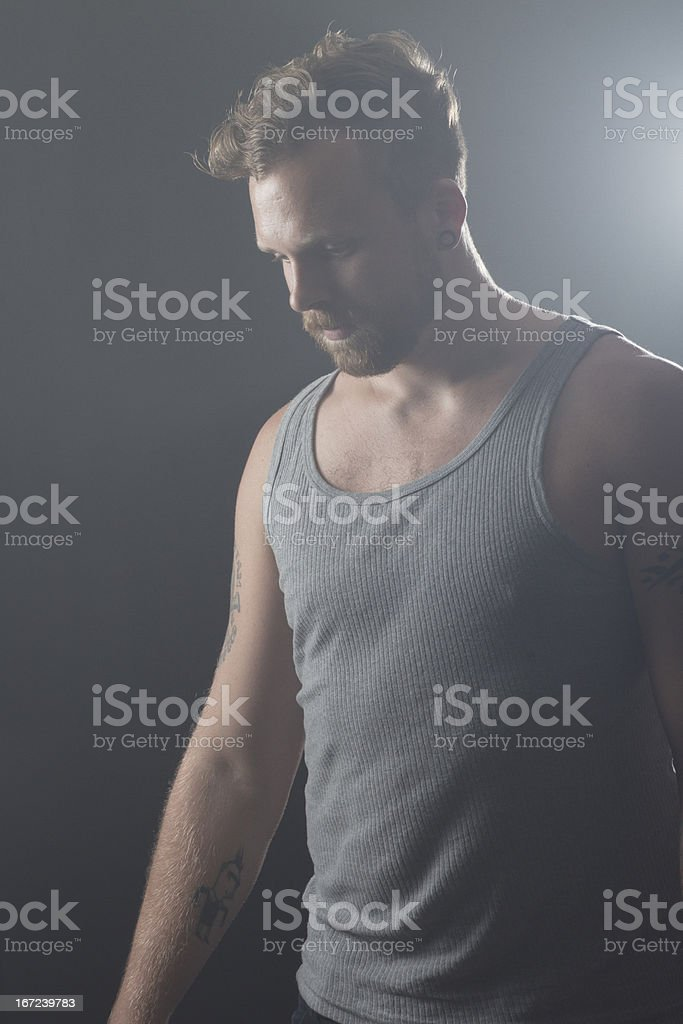 Rocker with Tattoos in Profile royalty-free stock photo