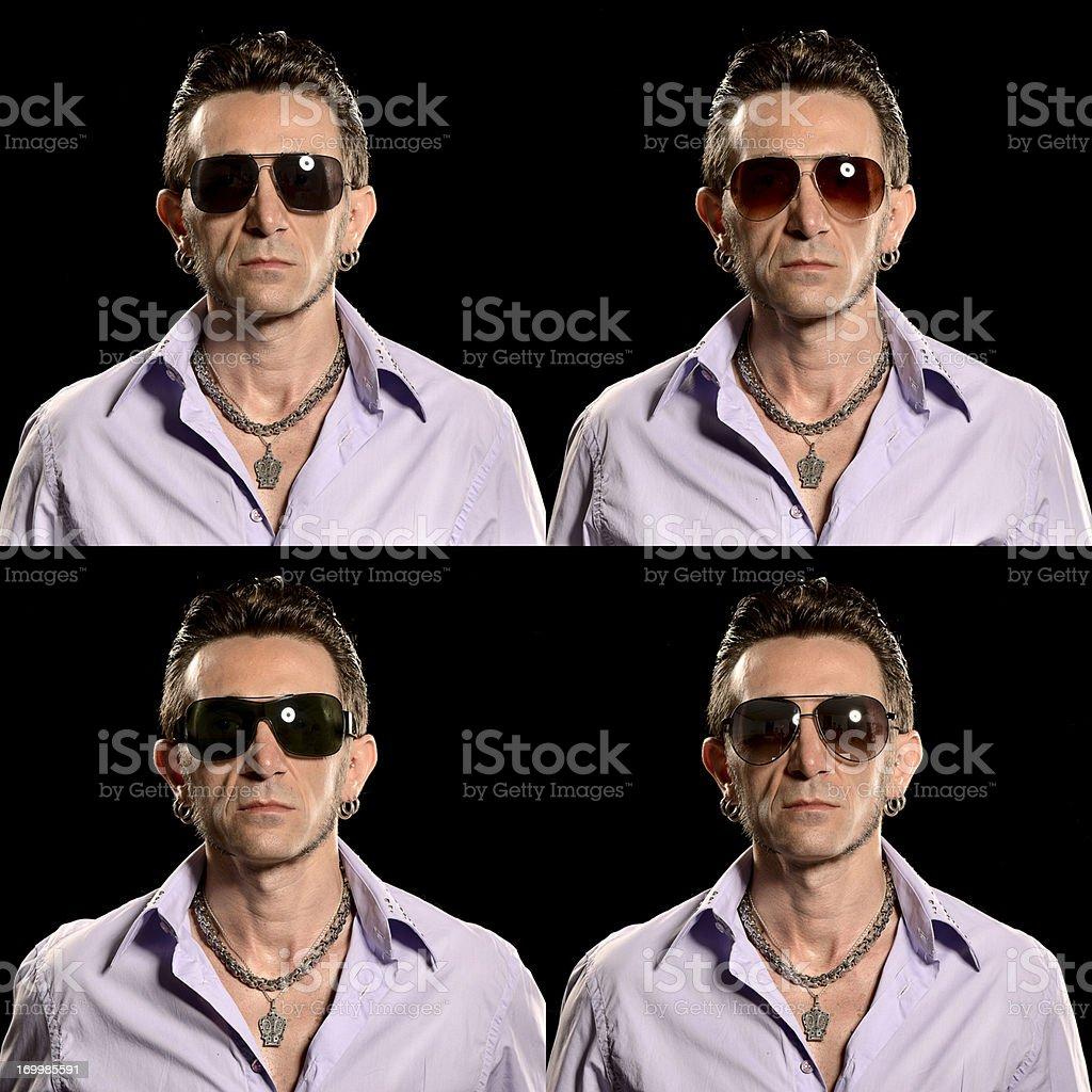 Rocker/Biker studio portrait with four different sunglasses royalty-free stock photo