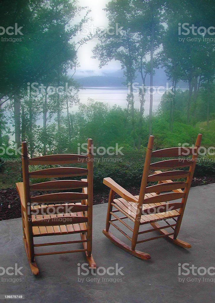 Rockers on the Porch overlooking lake stock photo