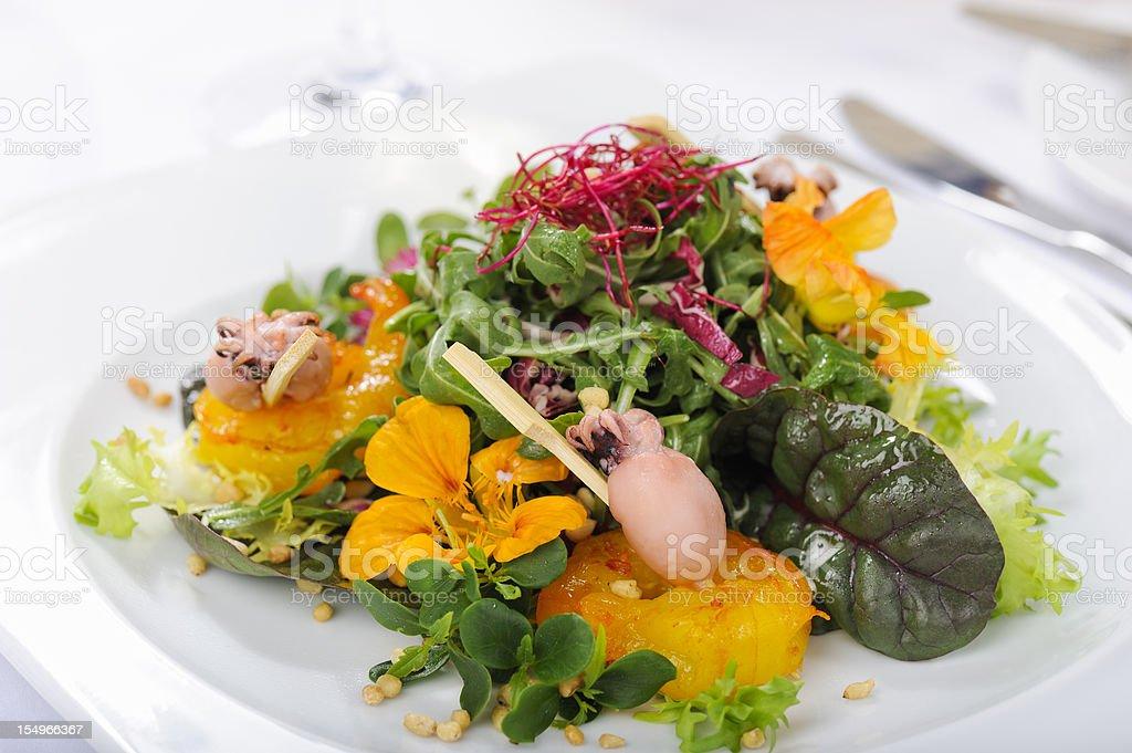 Rocket Salad with Baby Squid and Saffron Shrimp stock photo