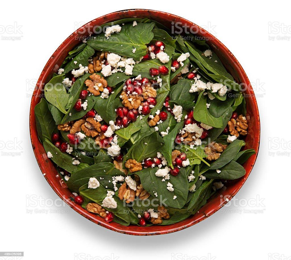 Rocket salad with feta cheese and pomegranates stock photo