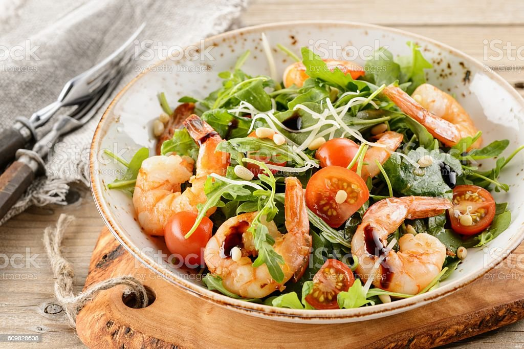 Rocket salad with prawns shrimps, sprouts and green cabbage on stock photo