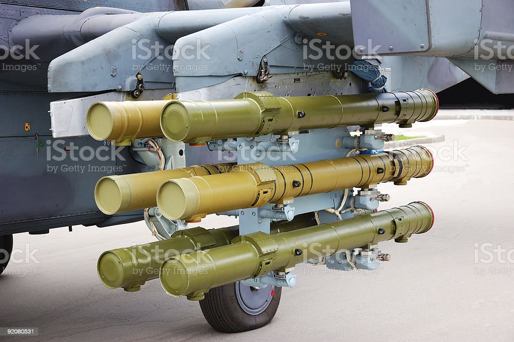 Rockets placed under a plane wing royalty-free stock photo