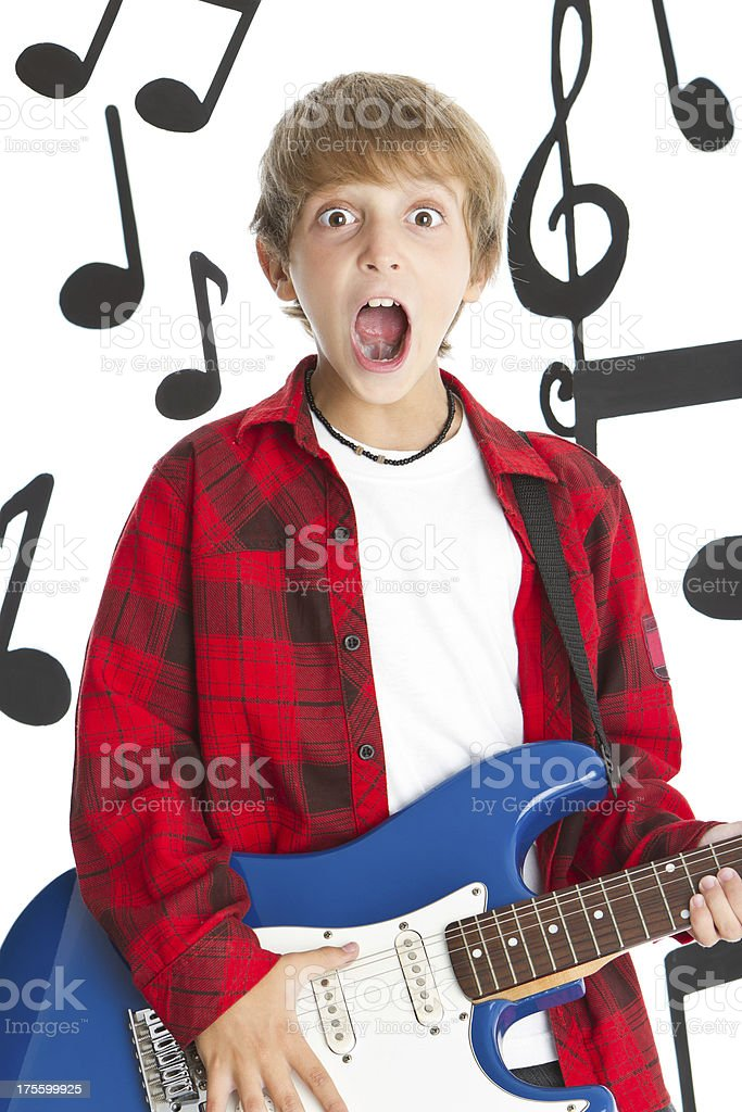Rocking boy sourrended by musical notes royalty-free stock photo
