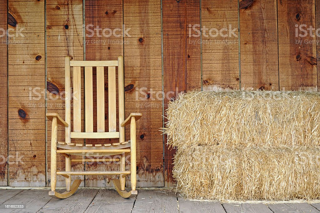Rocking chair and hay stack at the Farm. stock photo