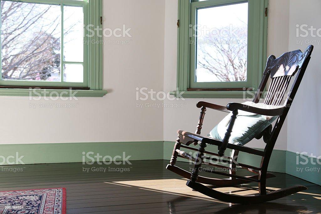 Rocking chair of the window foto de stock libre de derechos