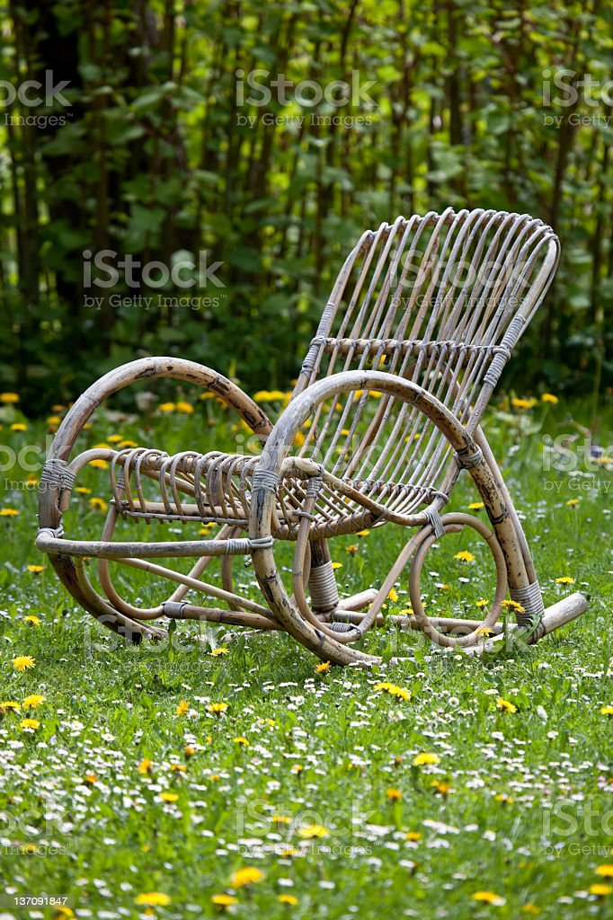 Rocking chair on meadow royalty-free stock photo
