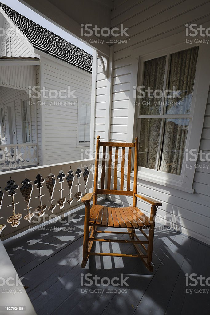 Rocking Chair on Porch of 19th Century House royalty-free stock photo