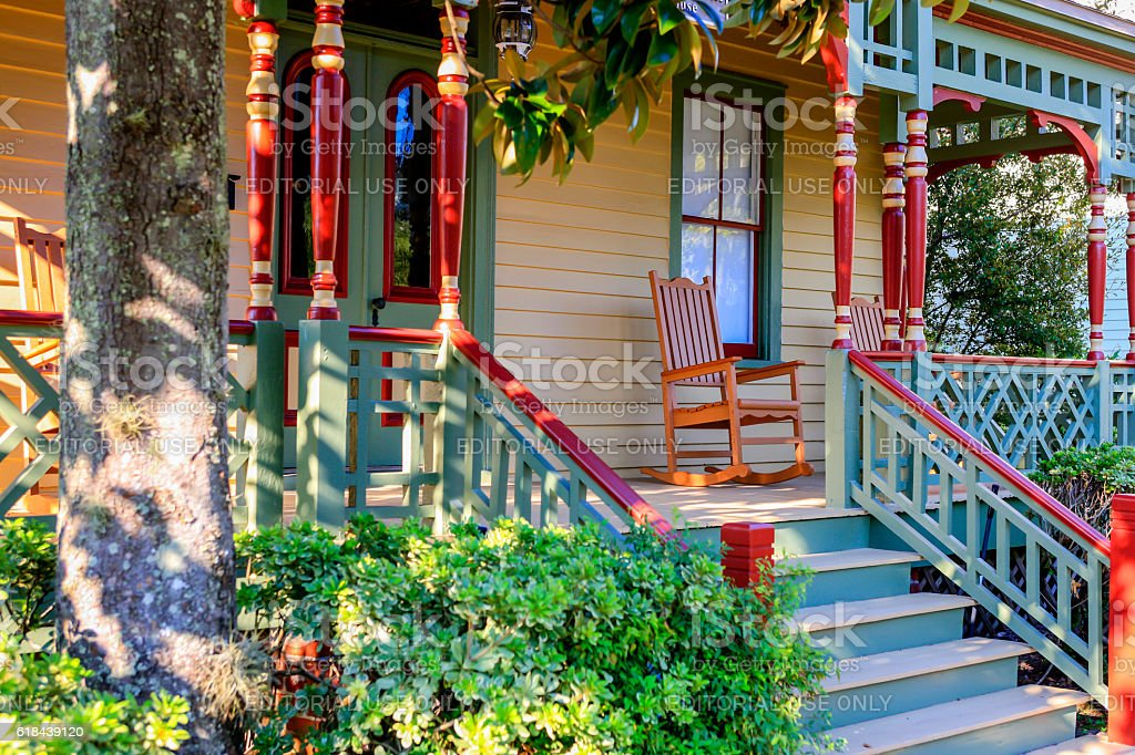 Rocking chair on the front porch of this home stock photo