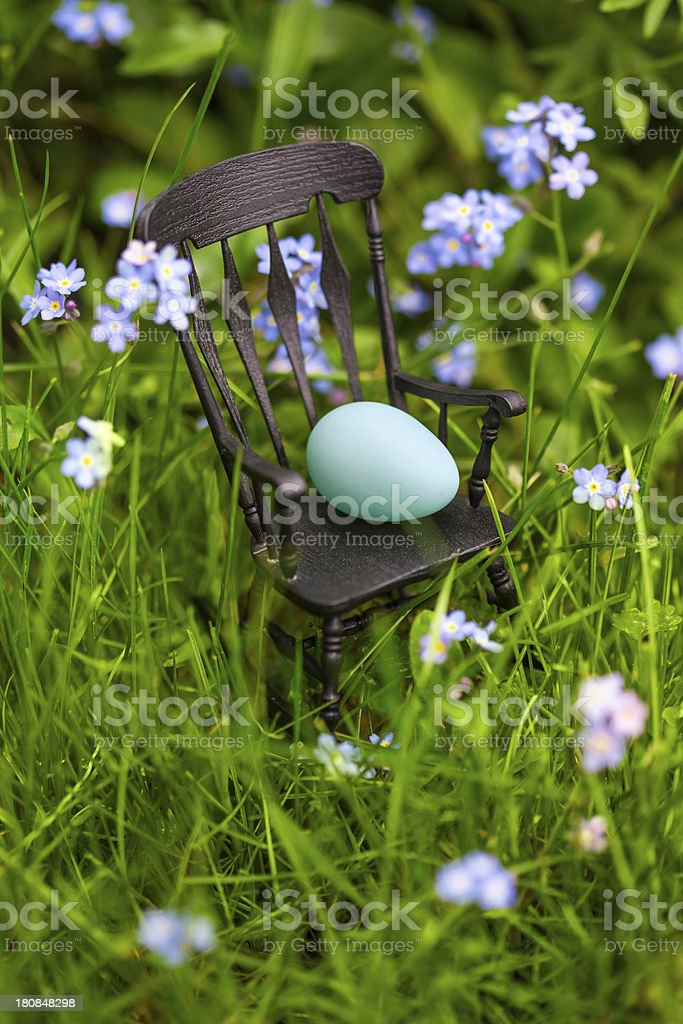 Rocking Chair With Egg in the Grass royalty-free stock photo