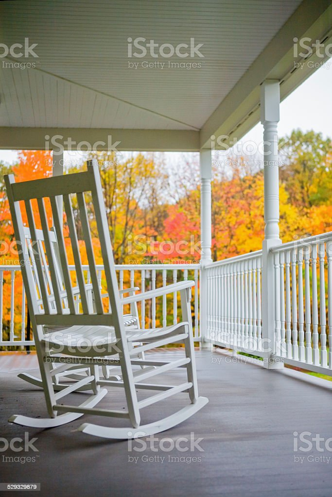 Rocking chairs on a porch in Autumn stock photo