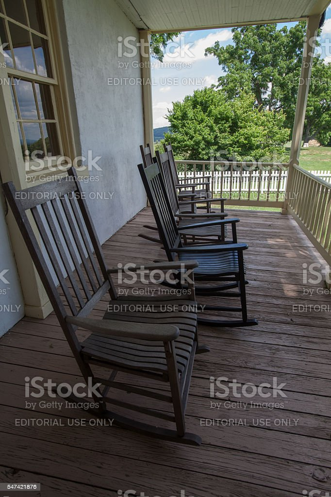 Rocking chairs on the porch of an old farmhouse stock photo