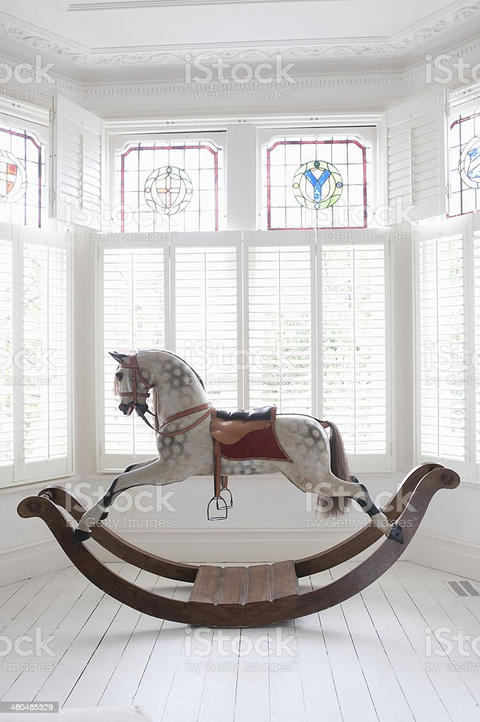 Rocking Horse In Bay Window stock photo