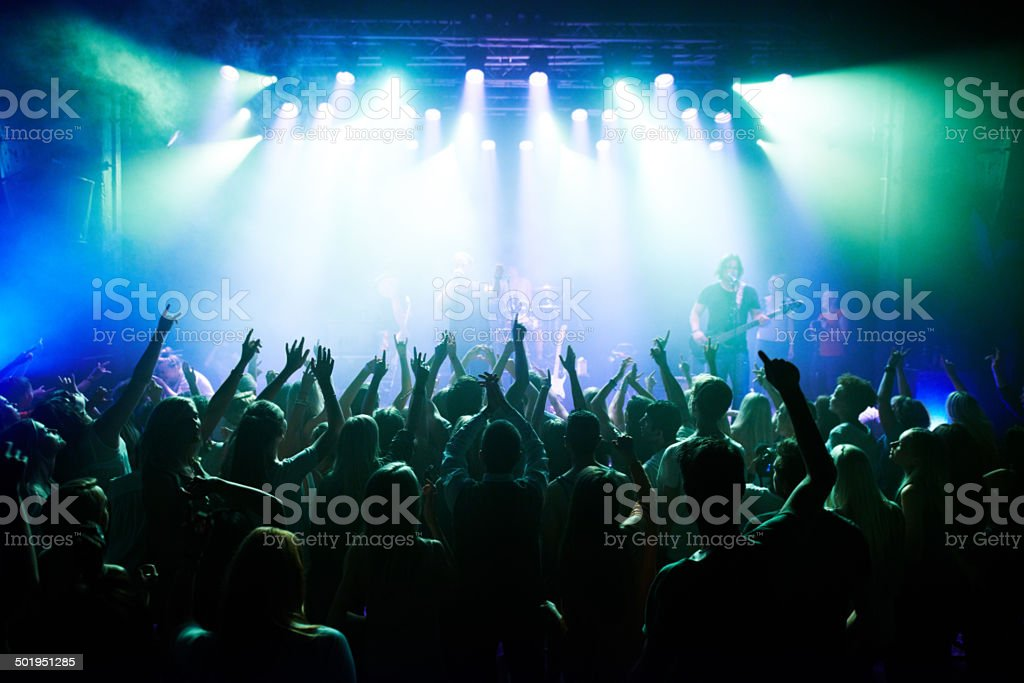 Rocking out to their favourite band stock photo
