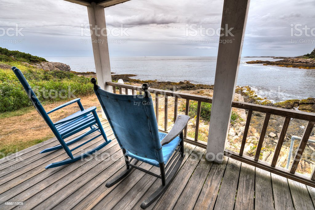 Rocking shairs on a porch with an ocean view stock photo