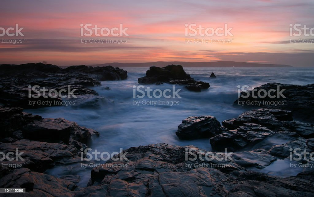 Rockpool motion blur waves at sunset in Cornwall stock photo