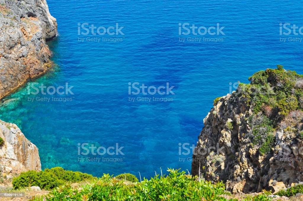 rocks and blue sea stock photo