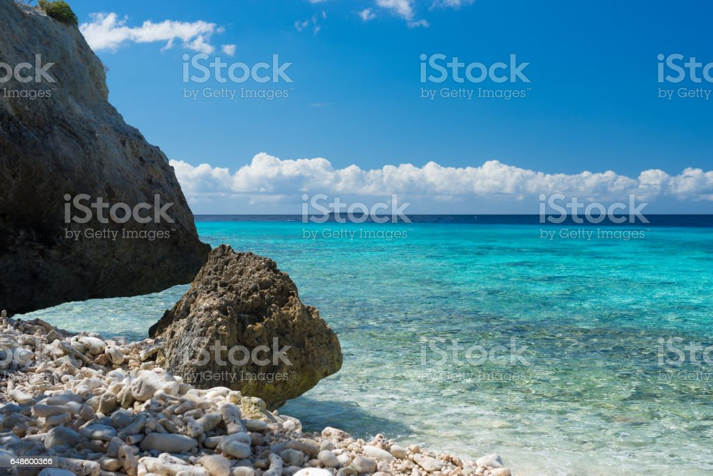 Rocks and clear water - swim paradise on tropical Curacao island, all seasons stock photo
