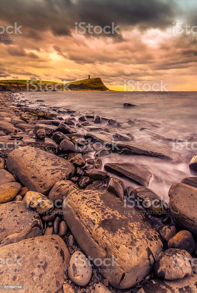 Rocks and ledges of Kimmeridge Bay at sunset stock photo