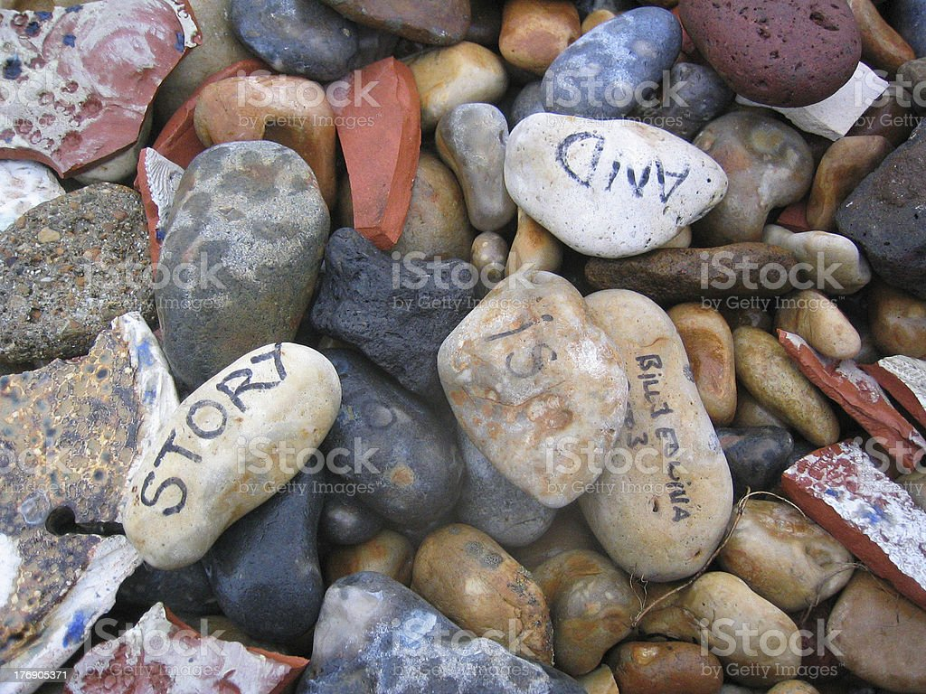 Rocks and pebbles with writing on royalty-free stock photo
