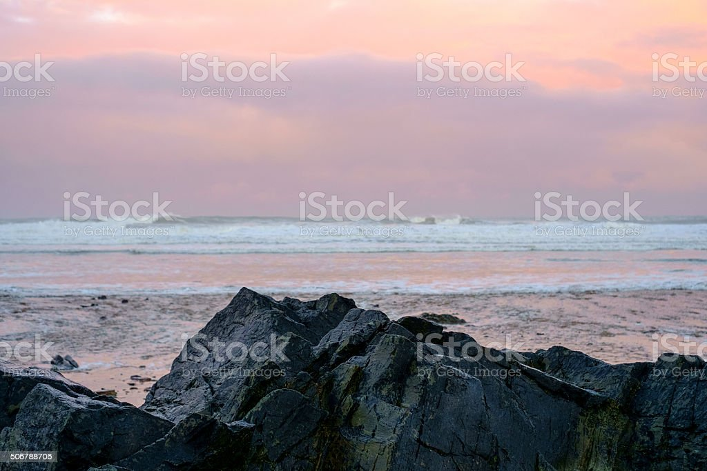 Rocks and pink sky and sea stock photo