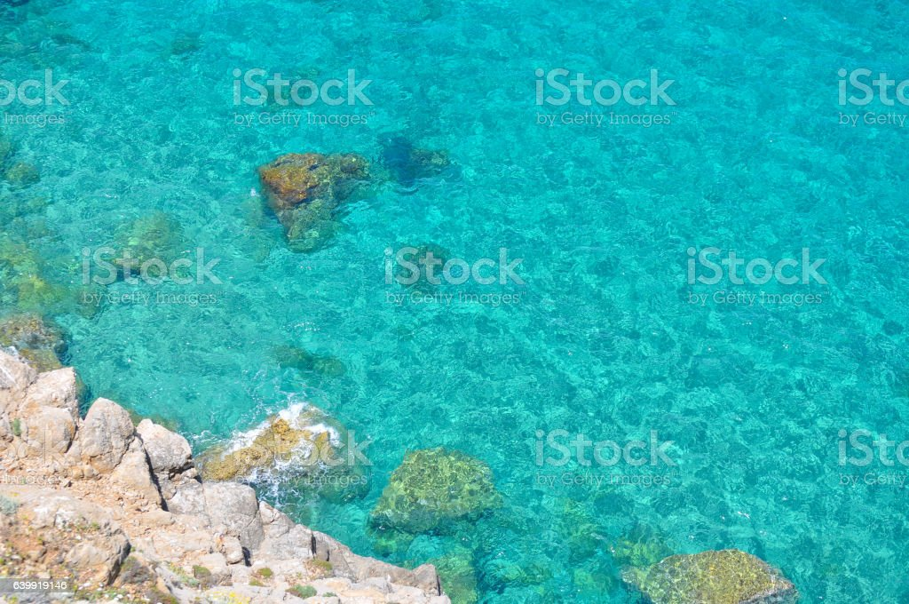 rocks and turquoise sea stock photo
