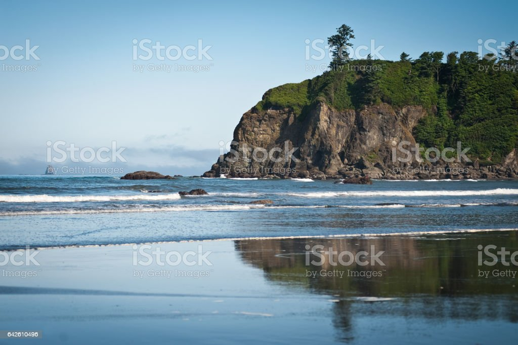 rocks and waves in quiet beach of Ruby Beach stock photo