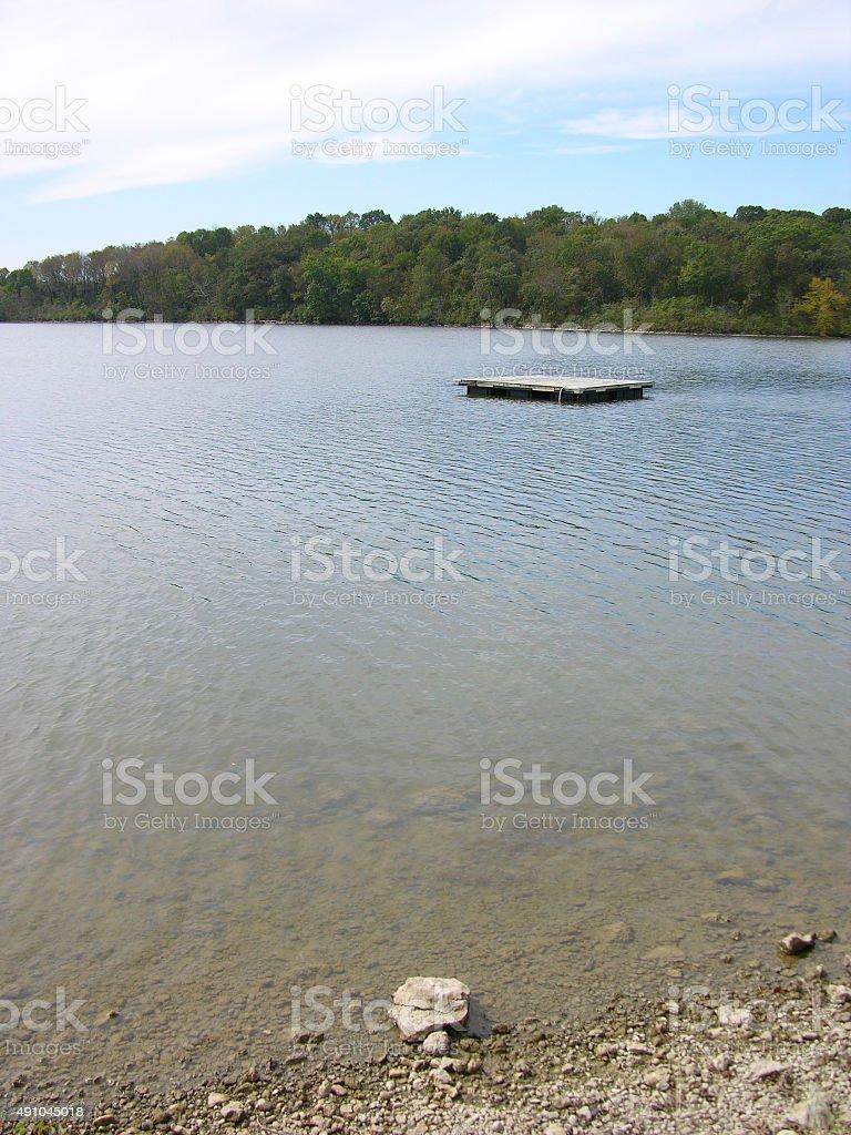 Rocks at the Edge of a Lake stock photo
