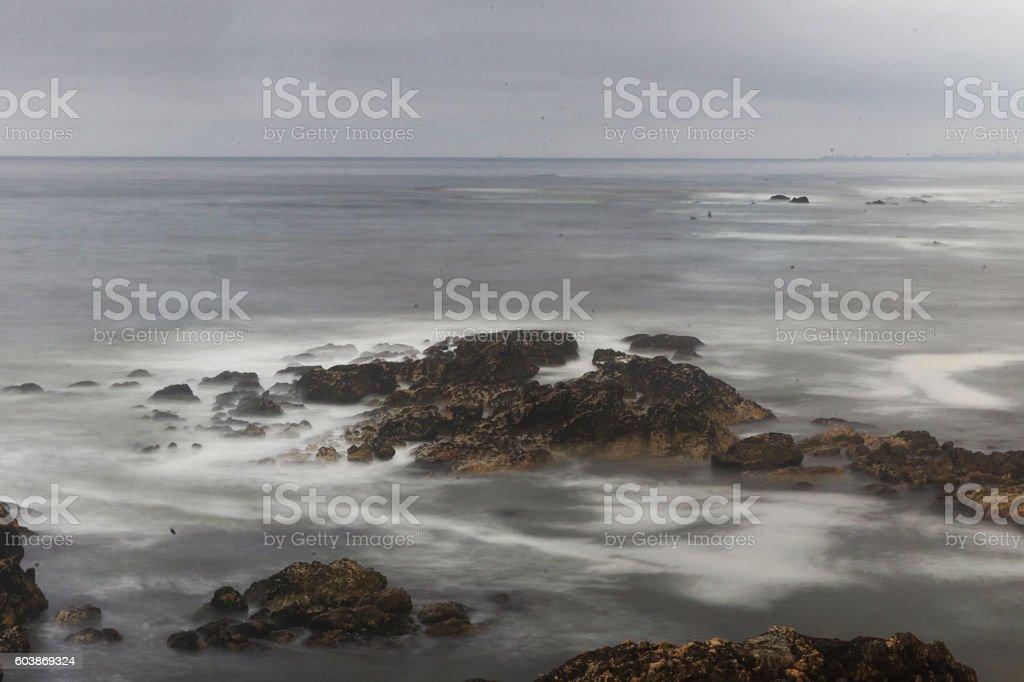 Rocks at the sea with dark sky stock photo