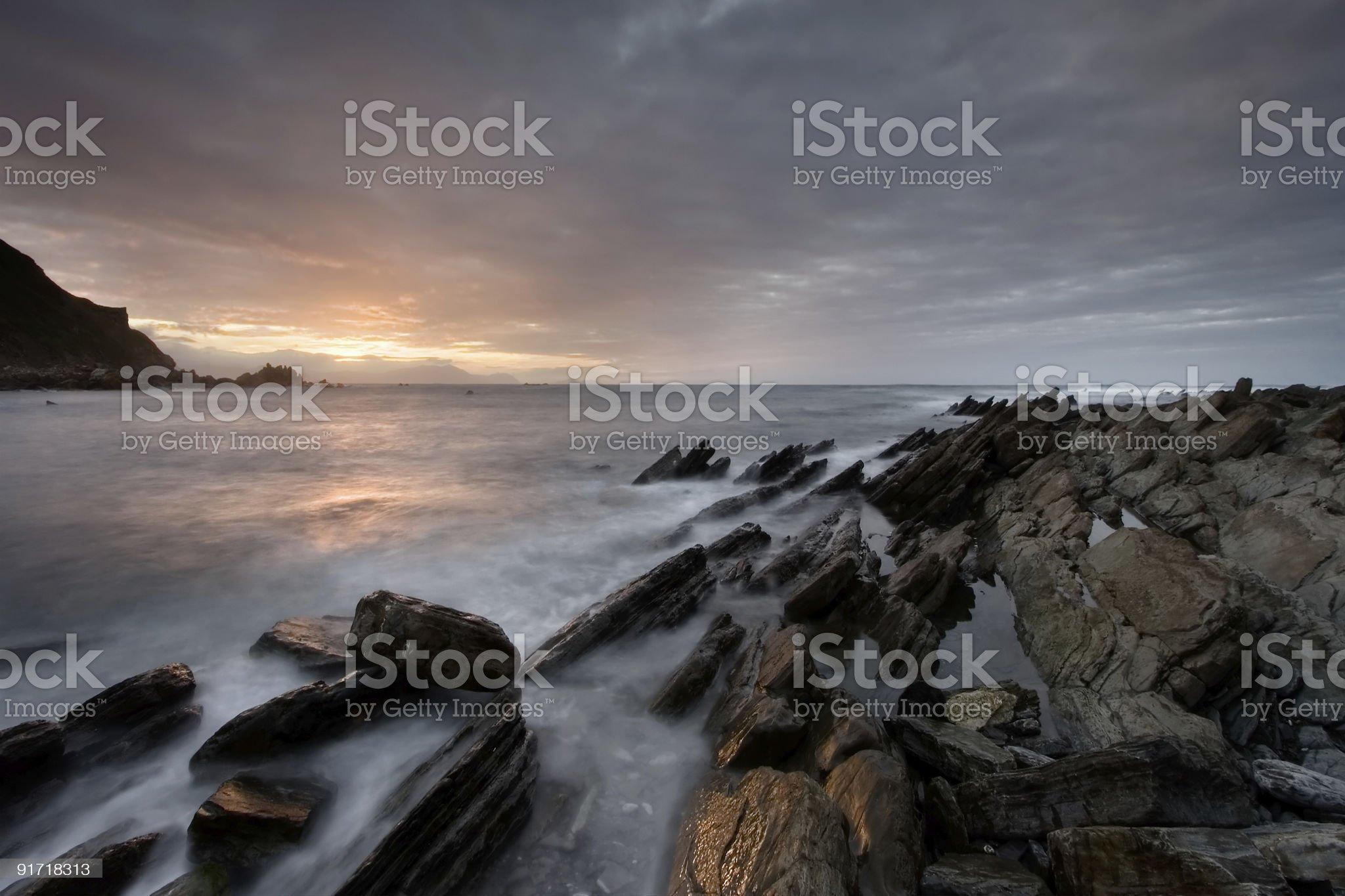 Rocks getting dark in the beach of Barrika royalty-free stock photo