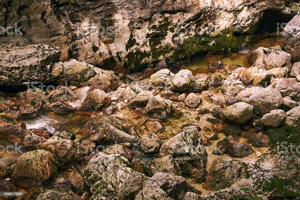 Rocks in a clear water of a mountain stream stock photo