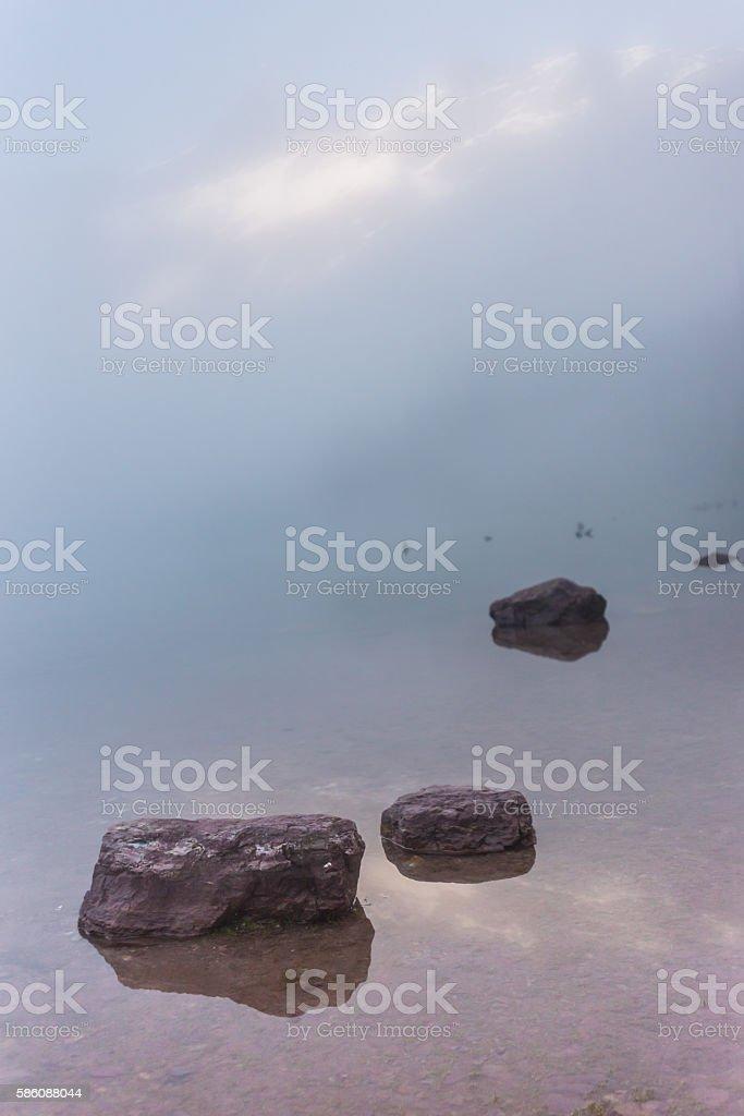 Rocks in Foggy Avalanche Lake stock photo