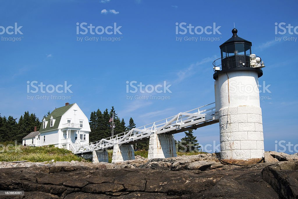 Rocks in front of Marshall Point Lighthouse stock photo
