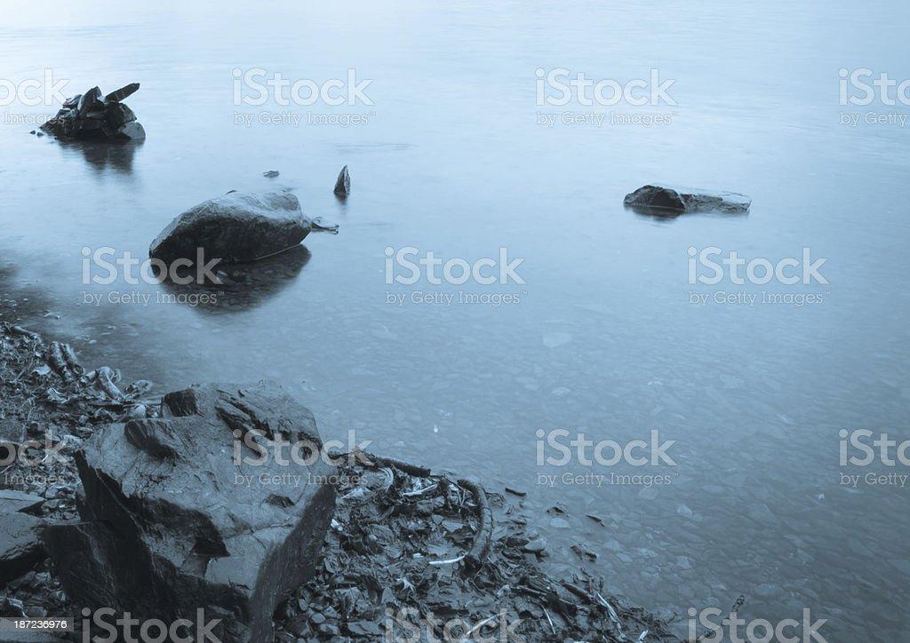 Rocks in Grasmere lake royalty-free stock photo