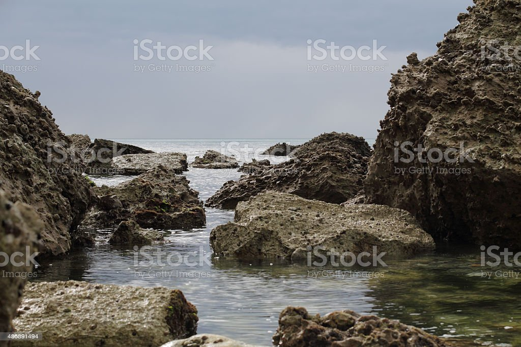 rocks in low tide stock photo