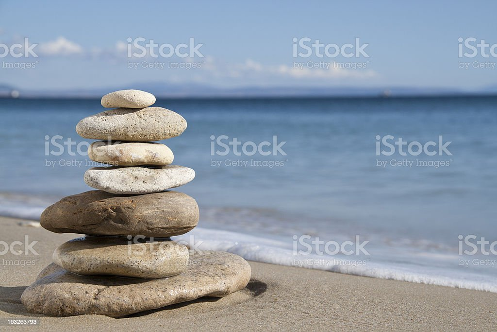Rocks in multiple sizes balanced on top of each other stock photo