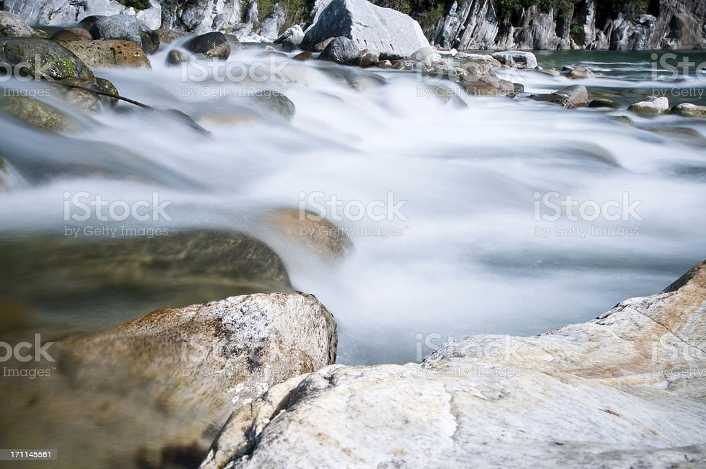 rocks in river spray and froth stock photo
