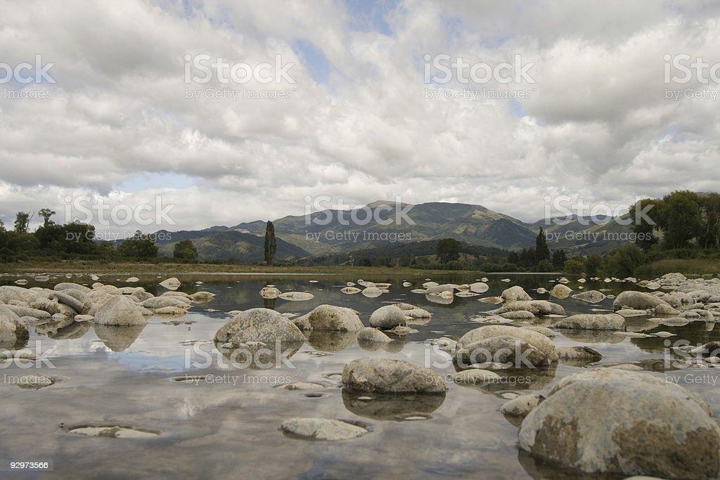 Rocks in shallows of Motueka River, South Island, New Zealand stock photo
