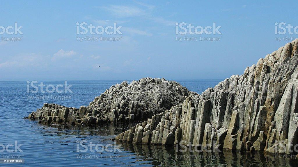 Rocks in Stolbchatiy cape, Kunashir stock photo