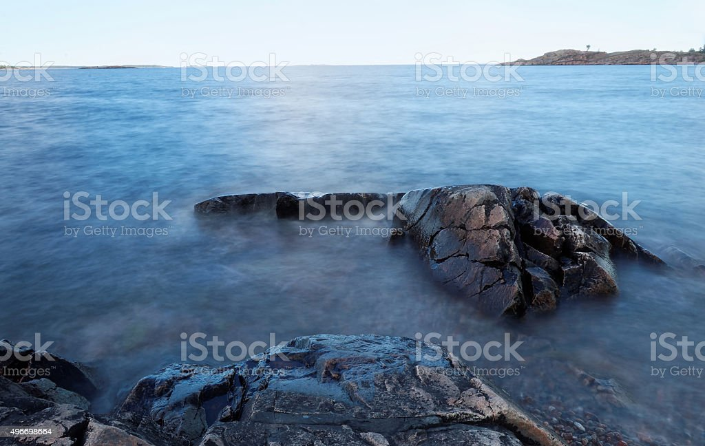Rocks in the milky water stock photo