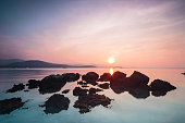 Rocks in the ocean with beautiful sky in sunset Time