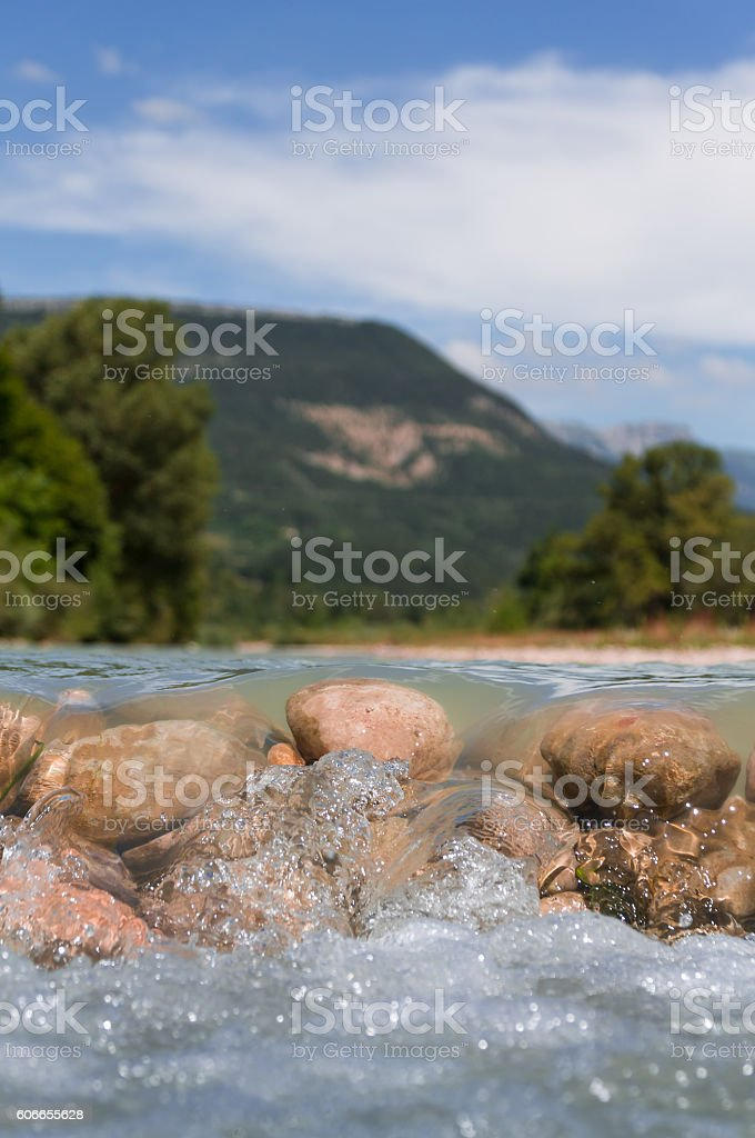 Rocks in the river, water flowing over them. stock photo