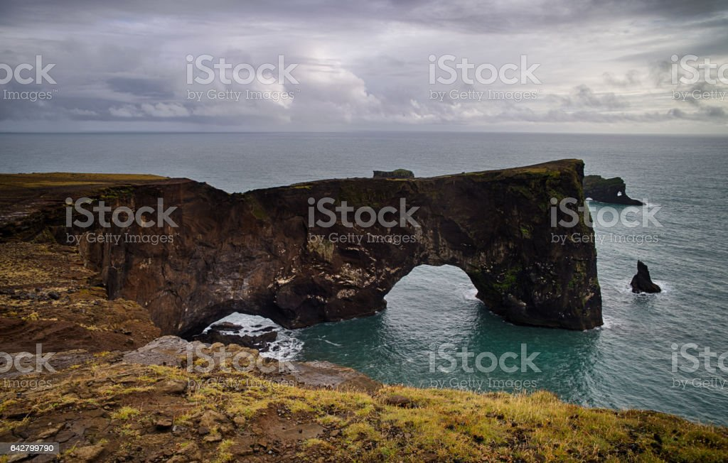 Rocks of Dyrholaey in Iceland stock photo