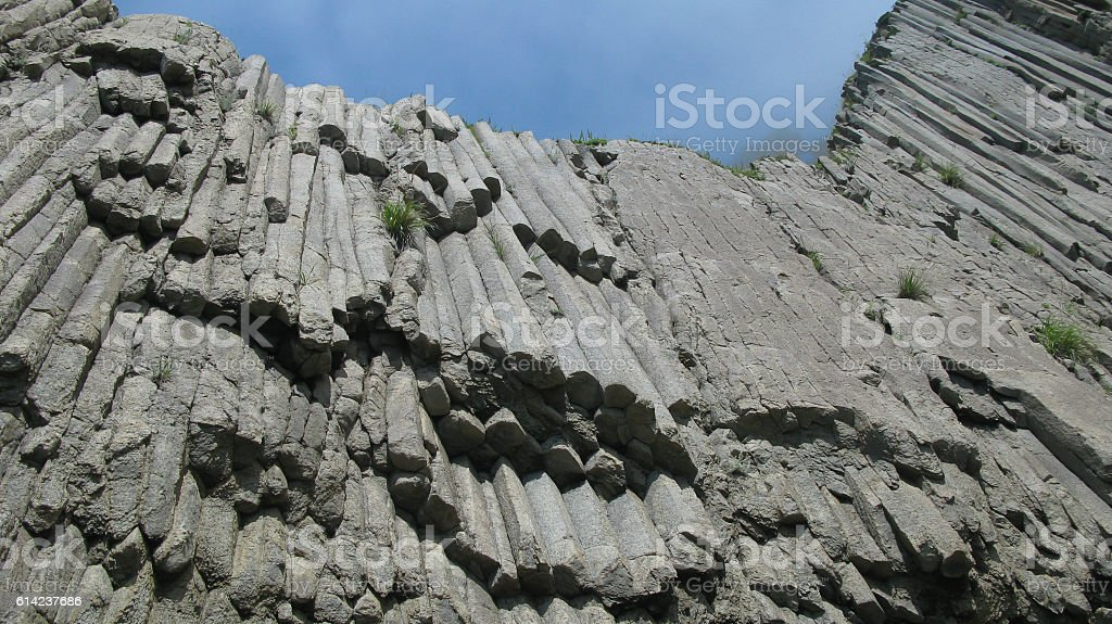 Rocks of Stolbchatiy cape in Kunashir, kuril islands, Russia stock photo