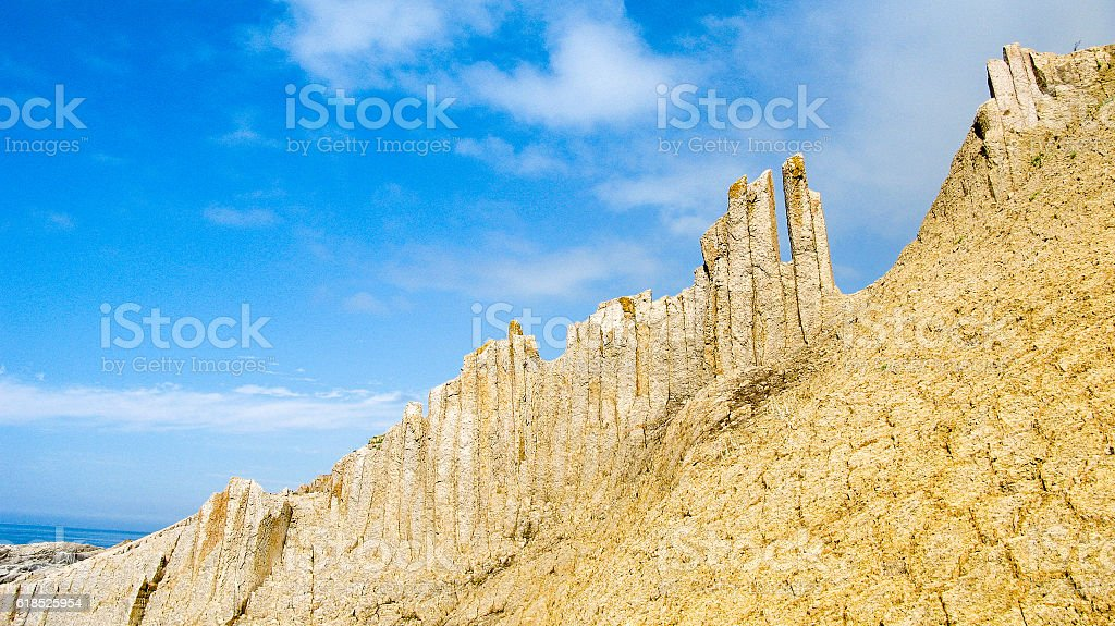 Rocks of Stolbchatiy cape in Kunashir, kuril islands Russia stock photo