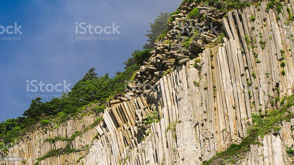 Rocks of Stolbchatiy cape in Kunashir, Kuril islands Russia stock photo